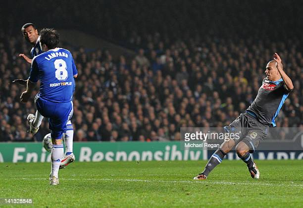 Gokhan Inler of Napoli shoots past Frank Lampard and Ashley Cole of Chelsea to score their first goal during the UEFA Champions League Round of 16...