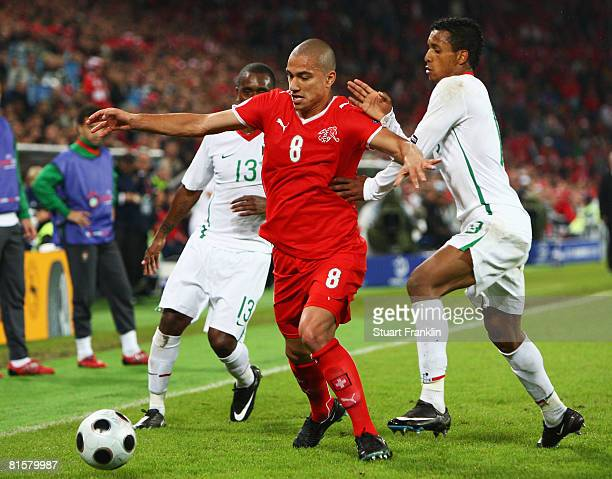 Gokhan Inler of Switzerland battles with Miguel and Nani of Portugal during the UEFA EURO 2008 Group A match between Switzerland and Portugal at St....