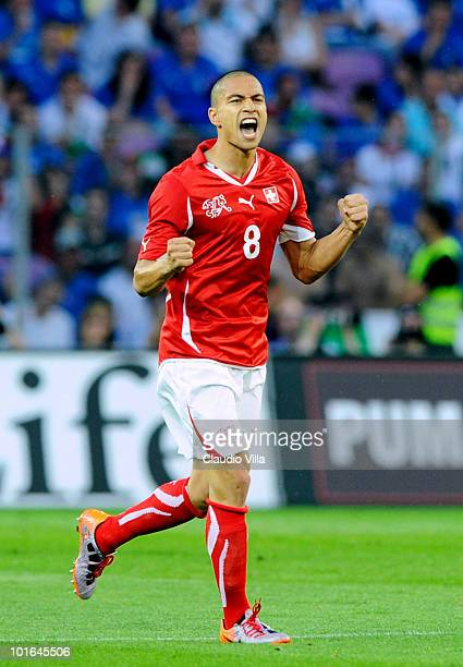 Gokhan Inler of Switzerland celebrates afterscoring his team's first goal during the international friendly match between Switzerland and Italy at...