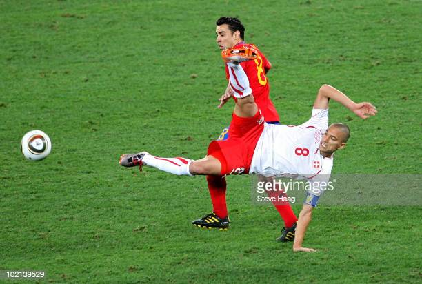Gokhan Inler of Switzerland tackles Xavi Hernandez of Spain during the 2010 FIFA World Cup South Africa Group H match between Spain and Switzerland...