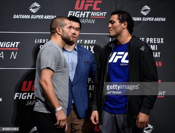 Gokhan Saki of Netherlands and Henrique da Silva of Brazil face off for the media during the UFC Ultimate Media Day at the Park Hyatt on September...