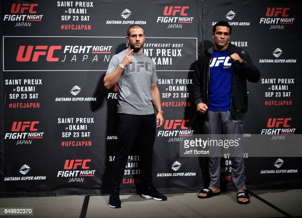 Gokhan Saki of Netherlands and Henrique da Silva of Brazil pose for the media during the UFC Ultimate Media Day at the Park Hyatt on September 20,...
