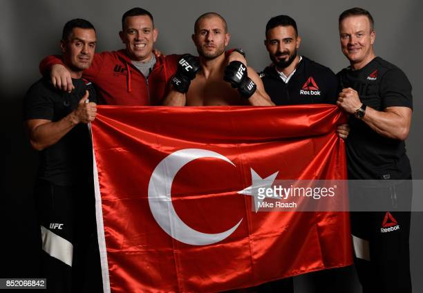 Gokhan Saki of Netherlands poses for a portrait backstage with his team during the UFC Fight Night event inside the Saitama Super Arena on September...