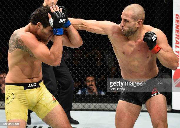 Gokhan Saki of Netherlands punches Henrique da Silva of Brazil in their light heavyweight bout during the UFC Fight Night event inside the Saitama...