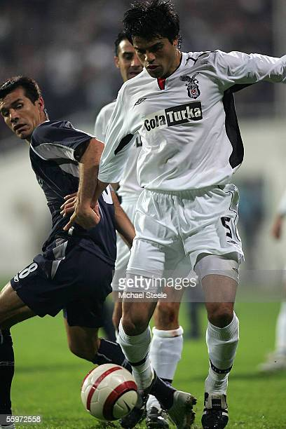 Gokhan Zan of Besiktas and Jared Borgetti of Bolton during the Uefa Cup Group H match between Besiktas and Bolton Wanderers at the BJK Inonu Stadium...