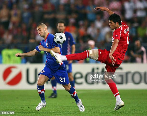 Gokhan Zan of Turkey battles for the ball with Mladen Petric of Croatia during the UEFA EURO 2008 Quarter Final match between Croatia and Turkey at...