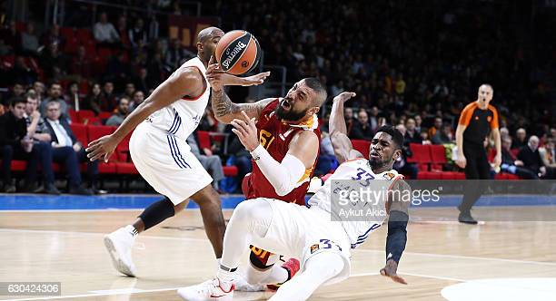 Goksenin Koksal #61 of Galatasaray Odeabank Istanbul competes with Paul Brandon #33 of Anadolu Efes Istanbul during the 2016/2017 Turkish Airlines...