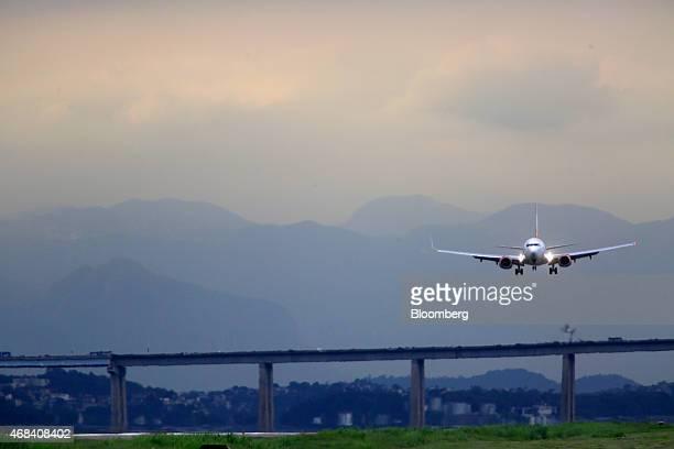 A Gol Linhas Aereas Inteligentes SA jet approaches Santos Dumont Airport for a landing in Rio de Janeiro Brazil on Tuesday March 31 2015 Brazil's...
