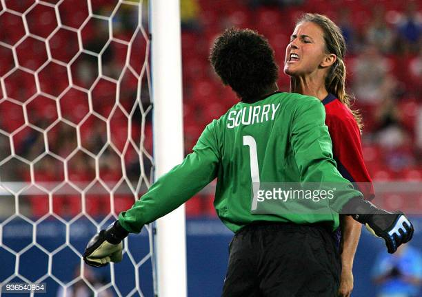 US golakeeper Briana Scurry talks with her teammate defender Brandi Chastain during their gold medal football match against Brazil at the Olympic...
