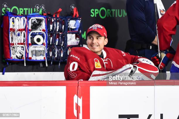 Golatender Zachary Fucale of the Laval Rocket smiles as he looks on from the bench against the Bridgeport Sound Tigers during the AHL game at Place...