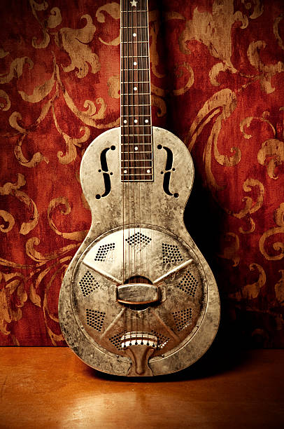 Resonator Guitar on Red Background