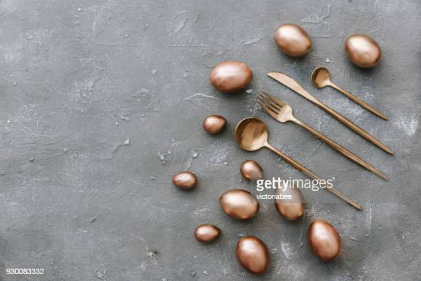 gold and black easter eggs with cutlery - eating utensil stock pictures, royalty-free photos & images