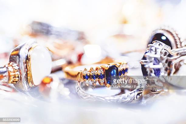 Gold And Diamond Rings On Table