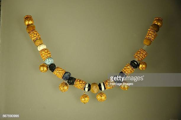 Gold and glass pastebead necklace from a woman's burial Culture Roman Period/ Date 6th 5th C BC Place of Origin Fidene Rome Credit Line Werner Forman...