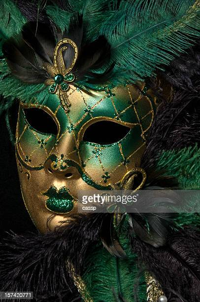 A gold and green masquerade mask