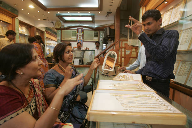 Gold and Jewellery Rekha Sanghvi and Santosh Jain at Umedmal Tilokchand Zaveri jewellery shop at Zaveri Bazaar Salesmen wait for the customers at...