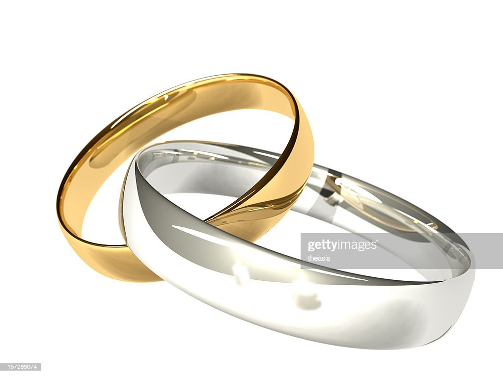 Gold and Platinum/Silver Wedding Rings - Reflected Candles : Stock Photo