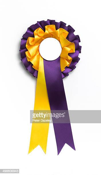 gold and purple rosette with copy space - award stock pictures, royalty-free photos & images
