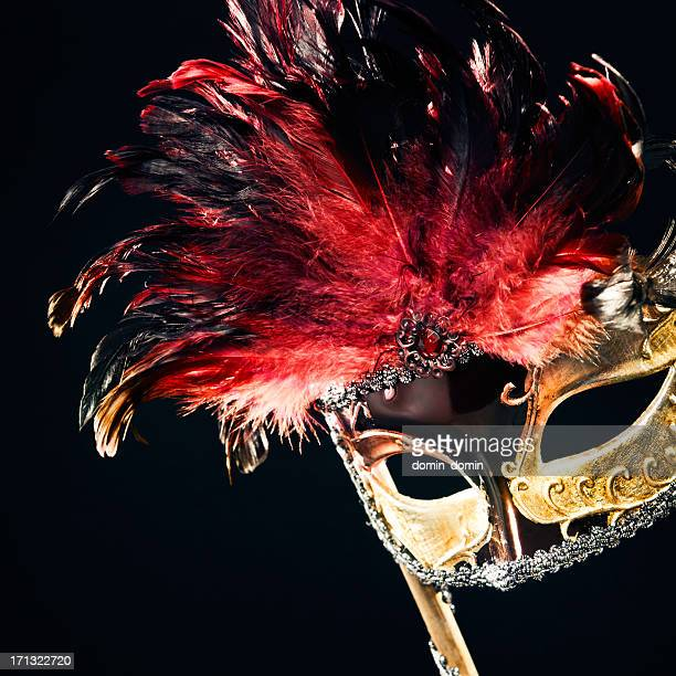 Gold and red Masquerade Mask with hand