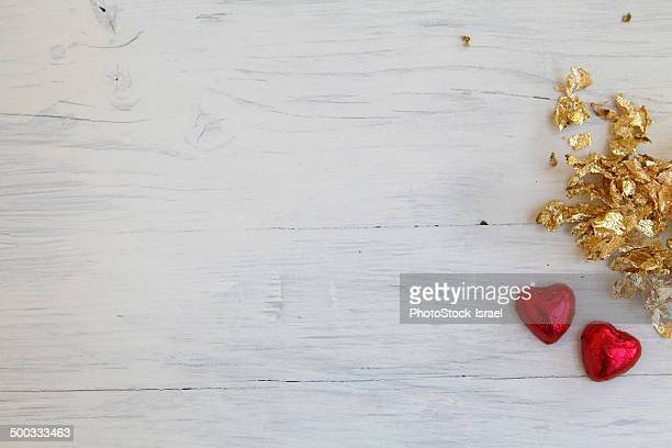 Gold and red on wood