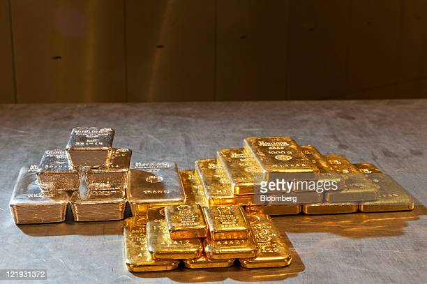 Gold and silver bars of different weights sit on a table in the vault of gold vendor ProAurum in Munich Germany on Tuesday Aug 23 2011 Gold advanced...