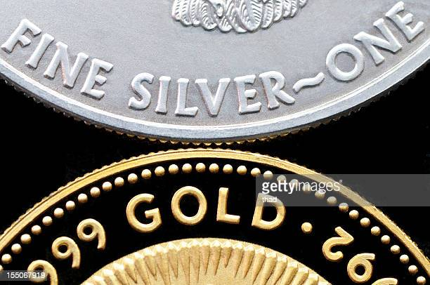 Gold and Silver Coins isolated on Black