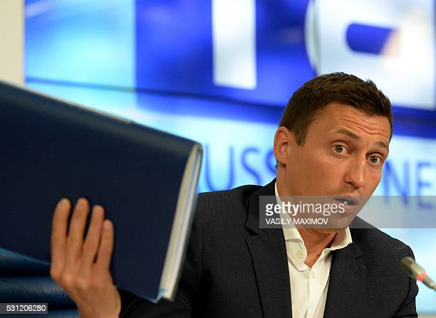 Gold and silver medalist at the 2014 Sochi Winter Olympics Russia's cross country skier Alexander Legkov speaks during a press conference on May 13...