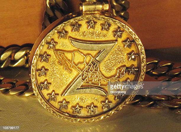 Gold and silver medallion seized from a member of the Los Zetas drug cartel sits on display at the Mexican Secretary of National Defense headquarters...