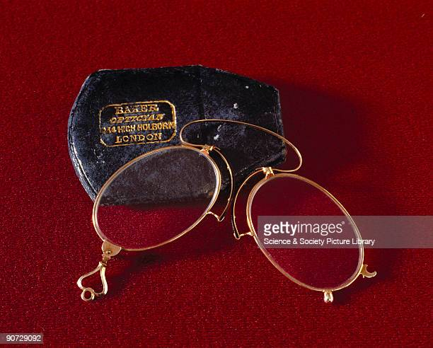 Gold and tortoiseshell folding spectacles in a black leather case made by Baker an optician in Holborn London Spectacles have been used in the West...