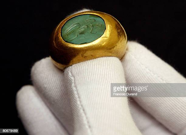 A gold and turquoise ring decorated with intaglio from the first century BC discovered in 1978 on the archeological site of Tillia Tepe and exhibited...