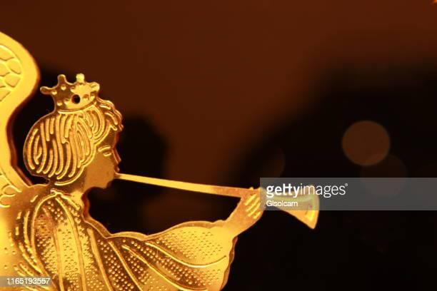 gold angel with trumpet ornament - kristendom bildbanksfoton och bilder