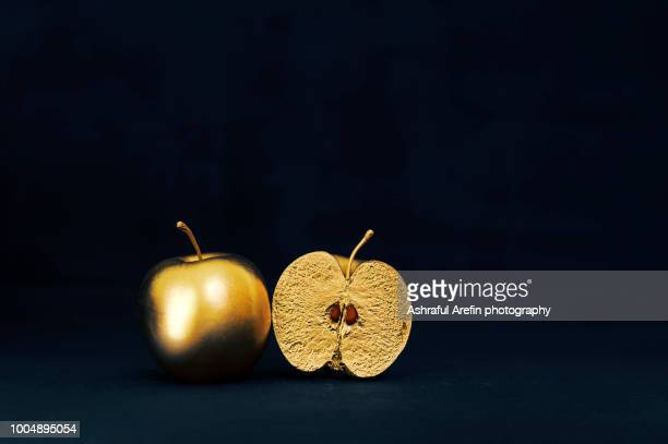 gold apples - desire stock pictures, royalty-free photos & images