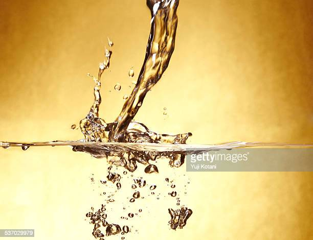Gold background and splash of water