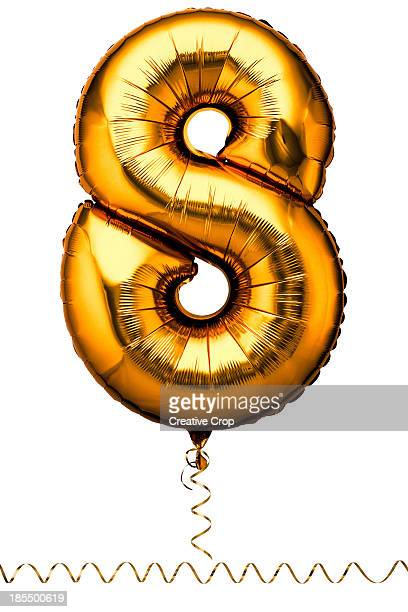 Gold balloon in the shape of a number eight