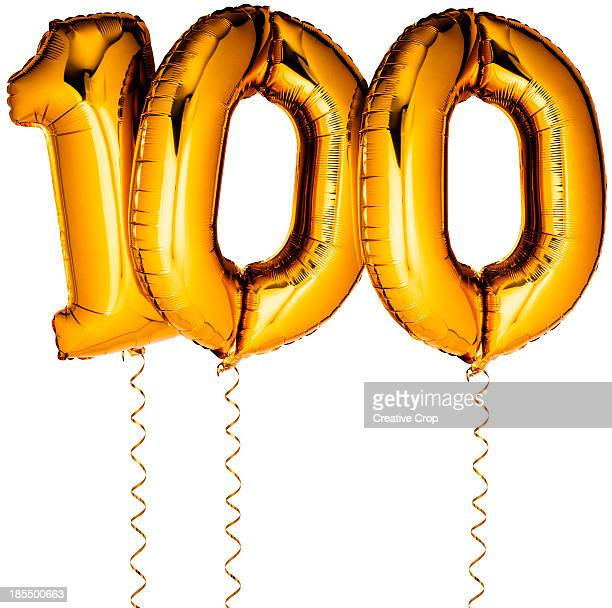 Gold balloons in the shape of a number 100