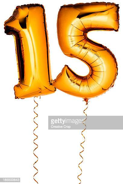 Gold balloons in the shape of a number 15