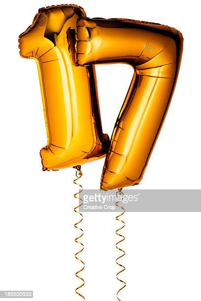 Gold balloons in the shape of a number 17