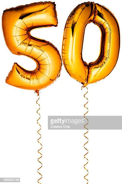 gold balloons in the shape of a number 50 - number 50 stock photos and pictures