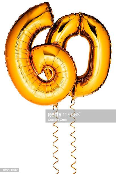 gold balloons in the shape of a number 60 - number 60 stock photos and pictures