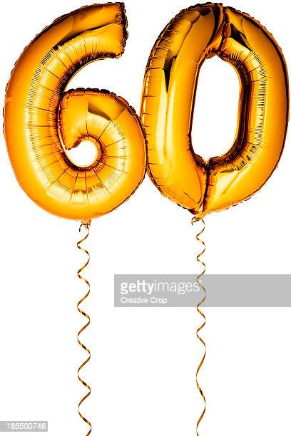 Gold balloons in the shape of a number 60