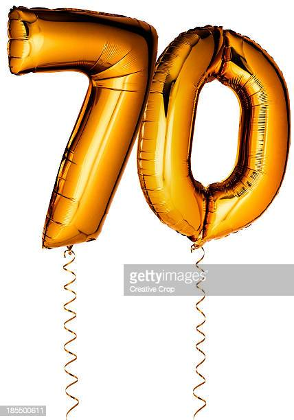 Gold balloons in the shape of a number 70