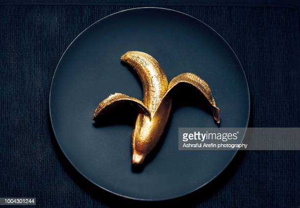 gold banana - gold stock pictures, royalty-free photos & images