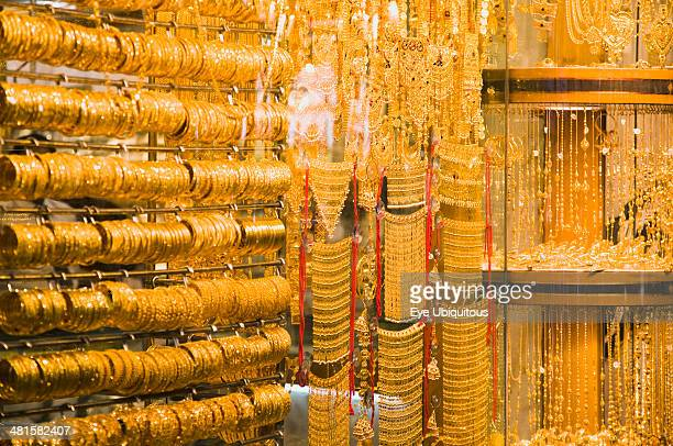 Gold bangles and jewelry in window display of Gold Souk Deira