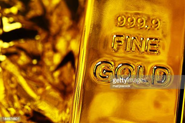 Gold bar of Fine Gold with gold background.