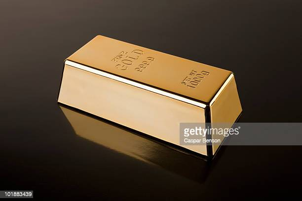 a gold bar - gold bars stock photos and pictures