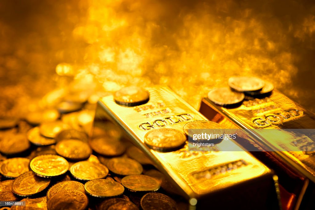 Gold bars and coins : Stock Photo
