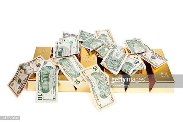 Gold bars und dollar-Banknoten