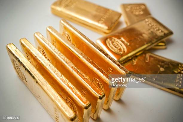 Gold bars are arranged for a photograph at Bullion Trading LLC in New York US on Tuesday Aug 23 2011 Gold dropped the most in a year as some...