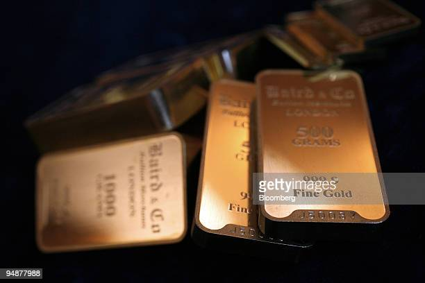 Gold bars are displayed at a bullion merchant's Baird Co in London UK on Friday March 14 2008 Gold futures fell the most in four months dropping...