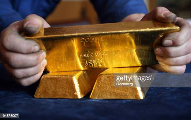 Gold bars are displayed at a bullion merchant's Baird Co in London UK on Friday March 14 2008 Gold may climb above $1000 an ounce in 2011 as global...